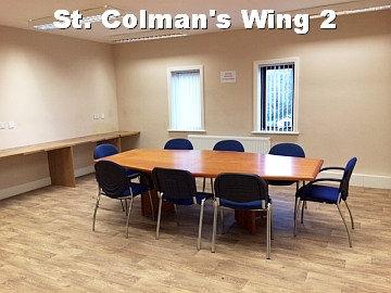 St. Colman's Wing 2 white text